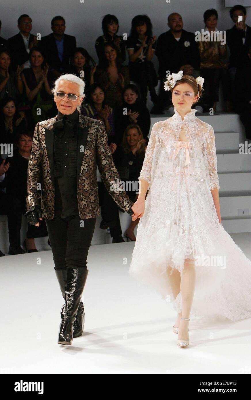 German fashion designer Karl Lagerfeld L escorts a model at the ...