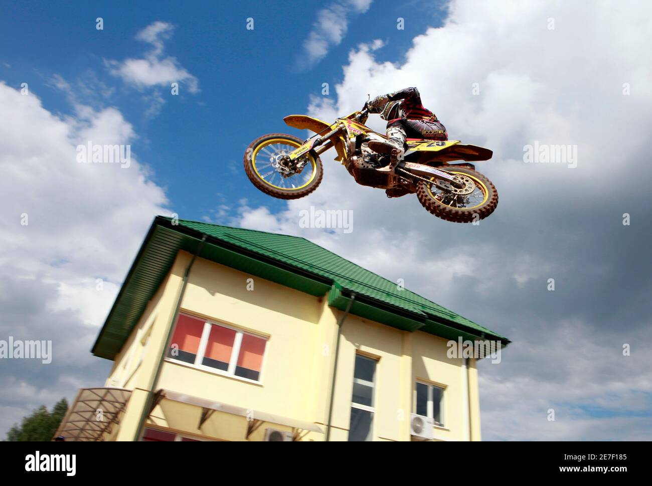 Clement Desalle of Belgium leads during the MX1 motocross World Championship Grand Prix of Latvia classification race in Kegums June 26, 2010. REUTERS/Ints Kalnins (LATVIA - Tags: SPORT MOTOR RACING) Stock Photo