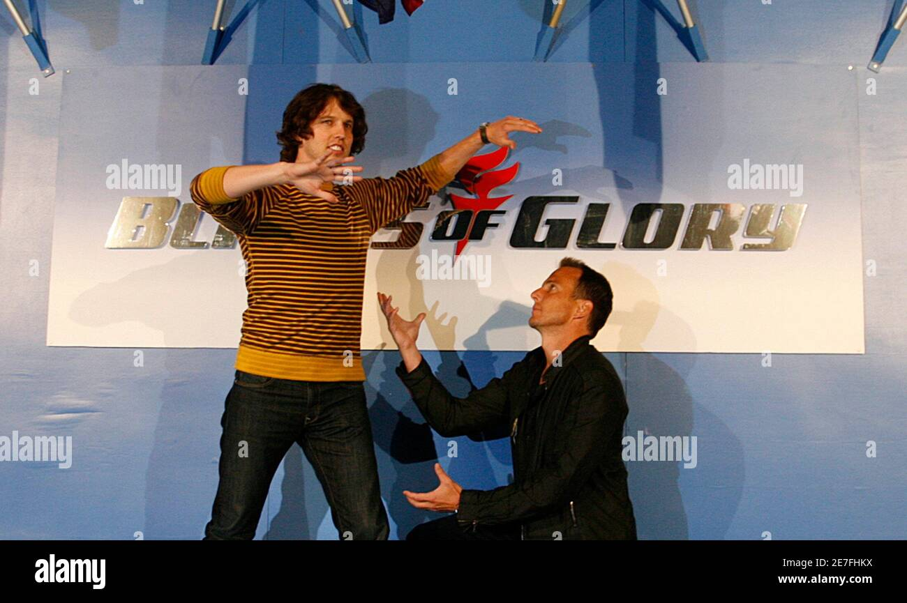 """Actors Jon Heder (L) and Will Arnett joke around at a media opportunity at an ice skating rink to promote their film """"Blades of Glory"""" in Sydney June 6, 2007.         REUTERS/Tim Wimborne     (AUSTRALIA) Stock Photo"""