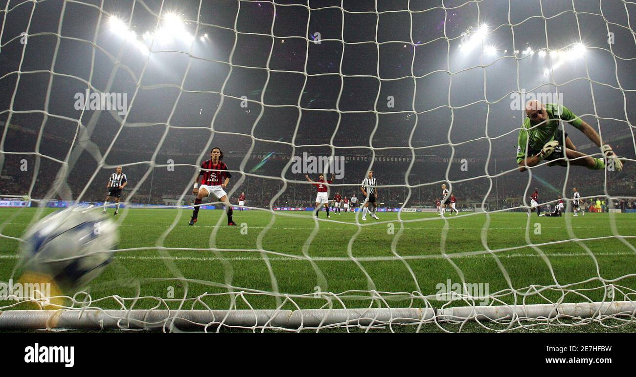 Juventus' goalkeeper Antonio Chimenti (R) flies through the air as AC Milan's Clarence Seedorf (unseen) shoots and scores during their Italian Serie A soccer match at the San Siro stadium in Milan October 29, 2005. AC Milan won 3-1. REUTERS/Alessandro Bianchi Stock Photo