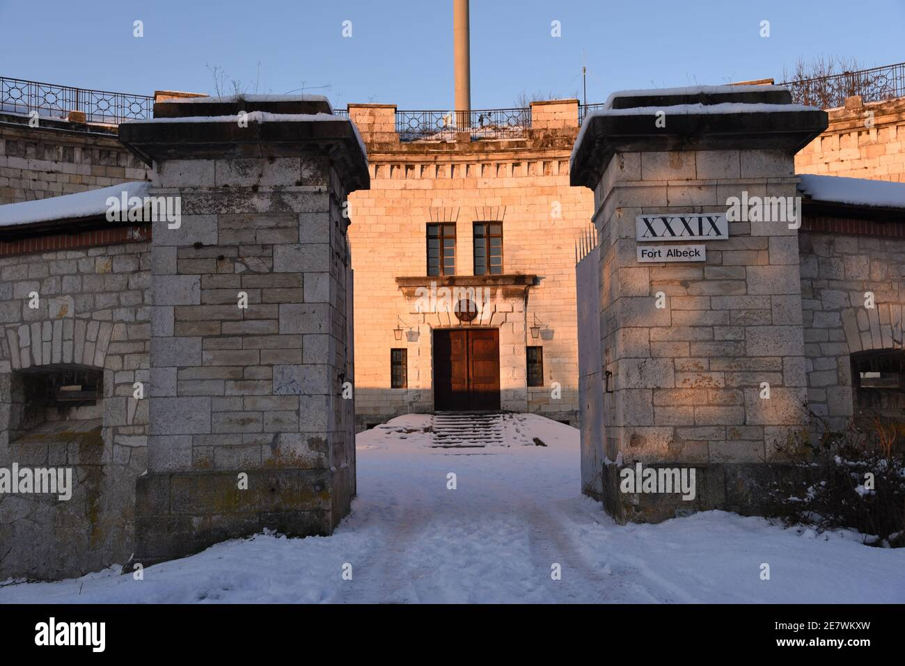 Fort Albeck during the golden hour surrounded by snow Stock Photo
