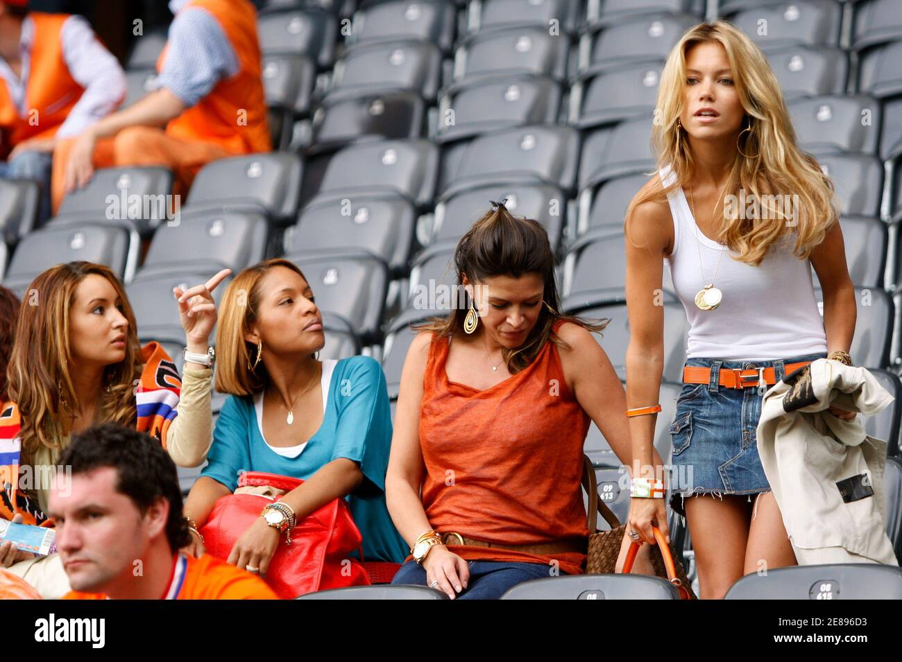 Sylvie Van der Vaart (R), wife of Netherlands' Rafael Van der Vaart, takes a seat beside Sabia Boulahrouz wife of Khalid Boulahrouz in the stands before their Group C Euro 2008 soccer match against Italy at the Stade de Suisse Stadium in Bern June 9, 2008.   REUTERS/Michael Kooren (SWITZERLAND)  MOBILE OUT. EDITORIAL USE ONLY Stock Photo