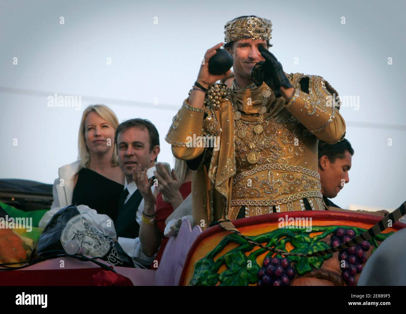 New Orleans Saints' quarterback Drew Brees, dressed as King of Bacchus, prepares to throw a toy football during the Bacchus Mardi Gras parade in New Orleans, Louisiana February 14, 2010. REUTERS/Lee Celano (UNITED STATES - Tags: SPORT SOCIETY FOOTBALL) Stock Photo