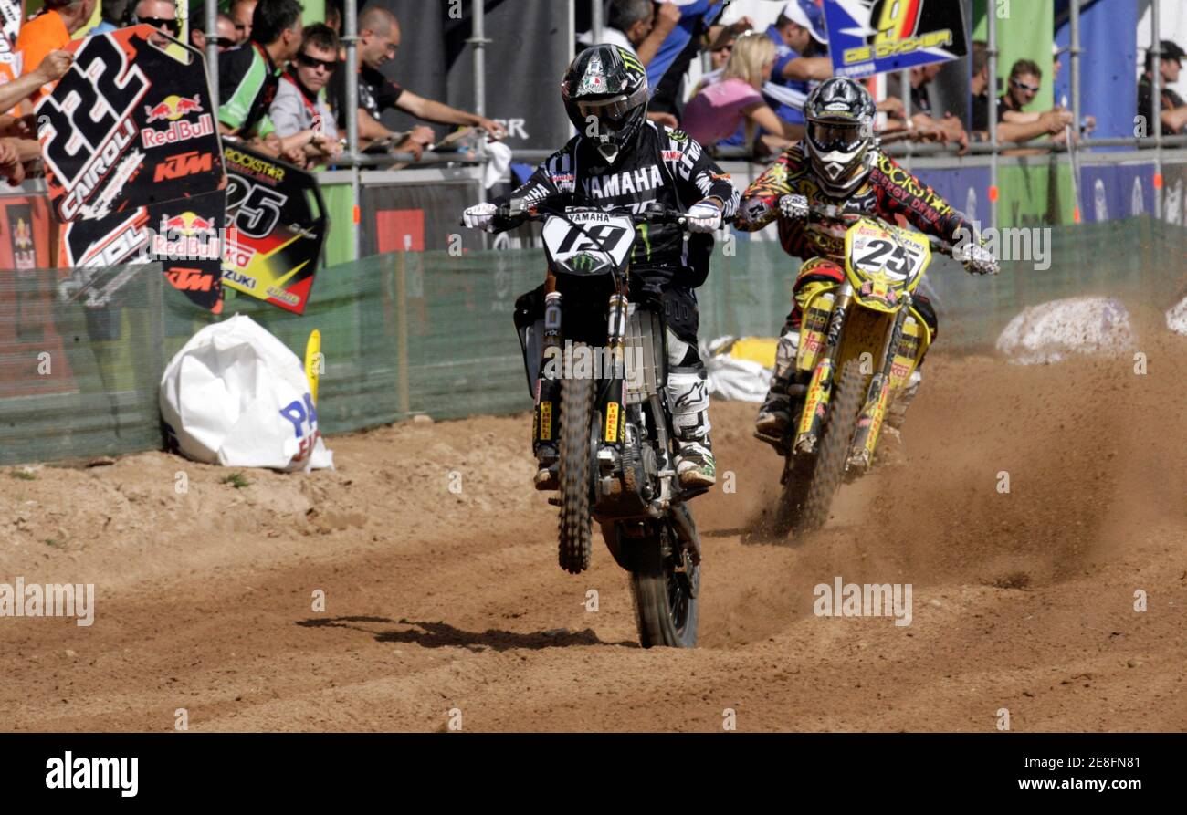 Clement Desalle (R) of Belgium and David Philippaerts of Italy compete during the MX1 motocross World Championship Grand Prix of Latvia classification race in Kegums June 26, 2010. REUTERS/Ints Kalnins (LATVIA - Tags: SPORT MOTOR RACING) Stock Photo
