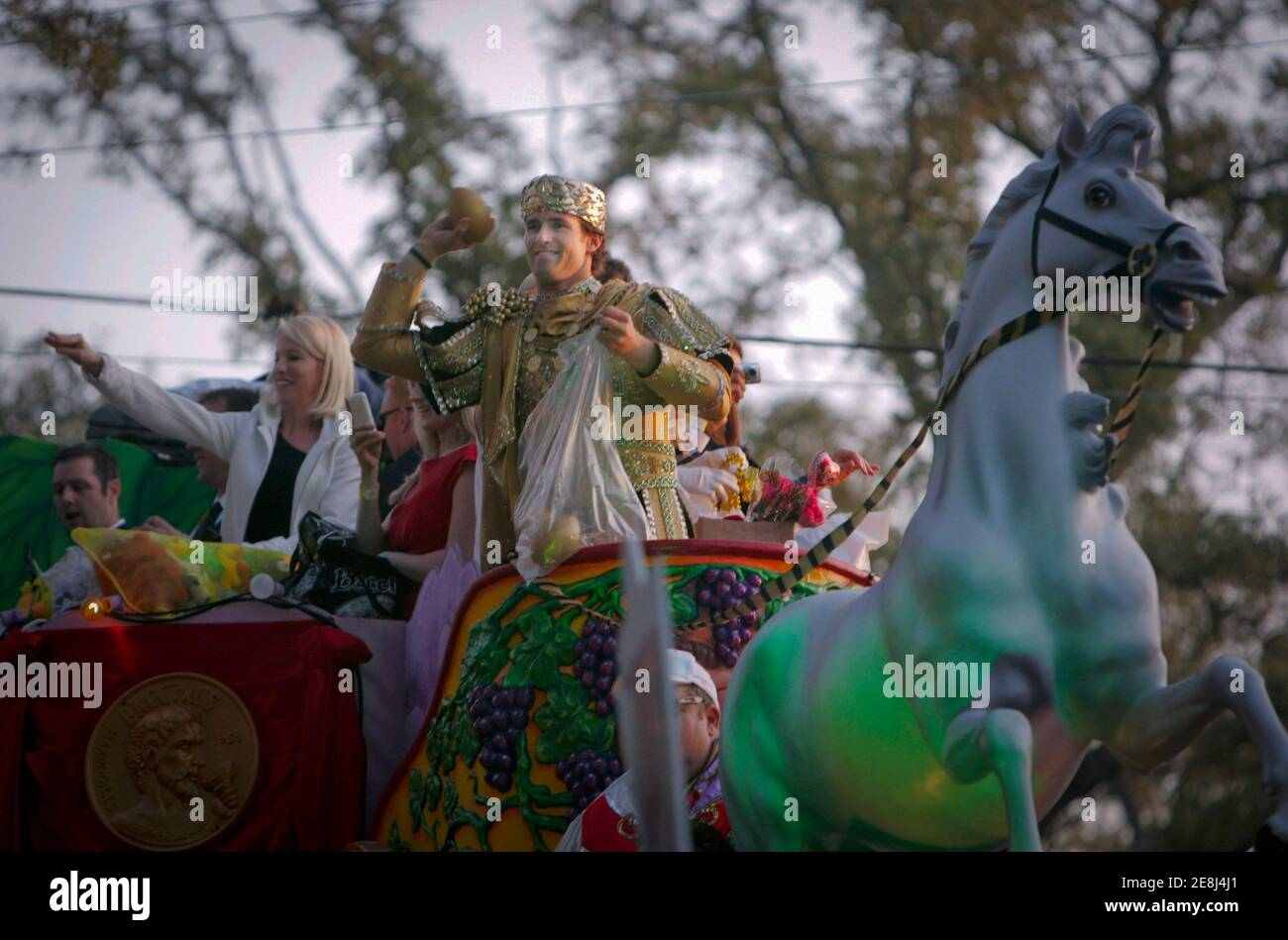 New Orleans Saints' quarterback Drew Brees, dressed as King of Bacchus, throws a toy football during the Bacchus Mardi Gras parade in New Orleans, Louisiana February 14, 2010. REUTERS/Lee Celano (UNITED STATES - Tags: SPORT FOOTBALL SOCIETY) Stock Photo