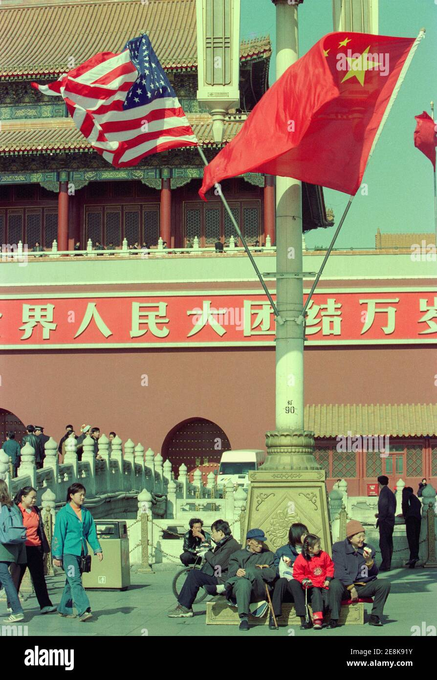 The Chinese and American flags fly over the area around Tiananmen Square during the days when American President George W. Bush visits China. 2002 Stock Photo