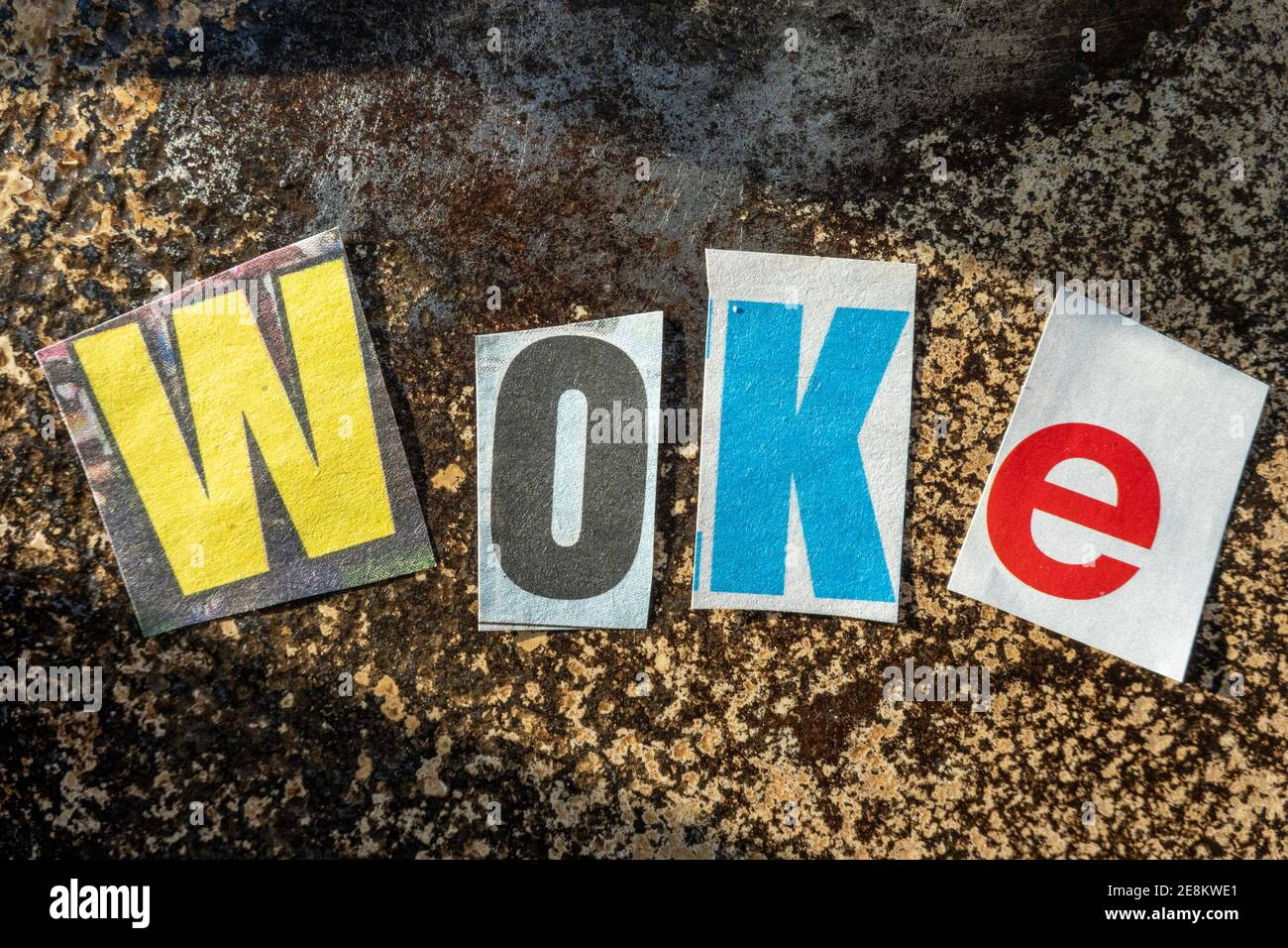 """TheTerm """"Stay WOKE"""" using cut-out paper letters in the ransom note effect typography Stock Photo"""