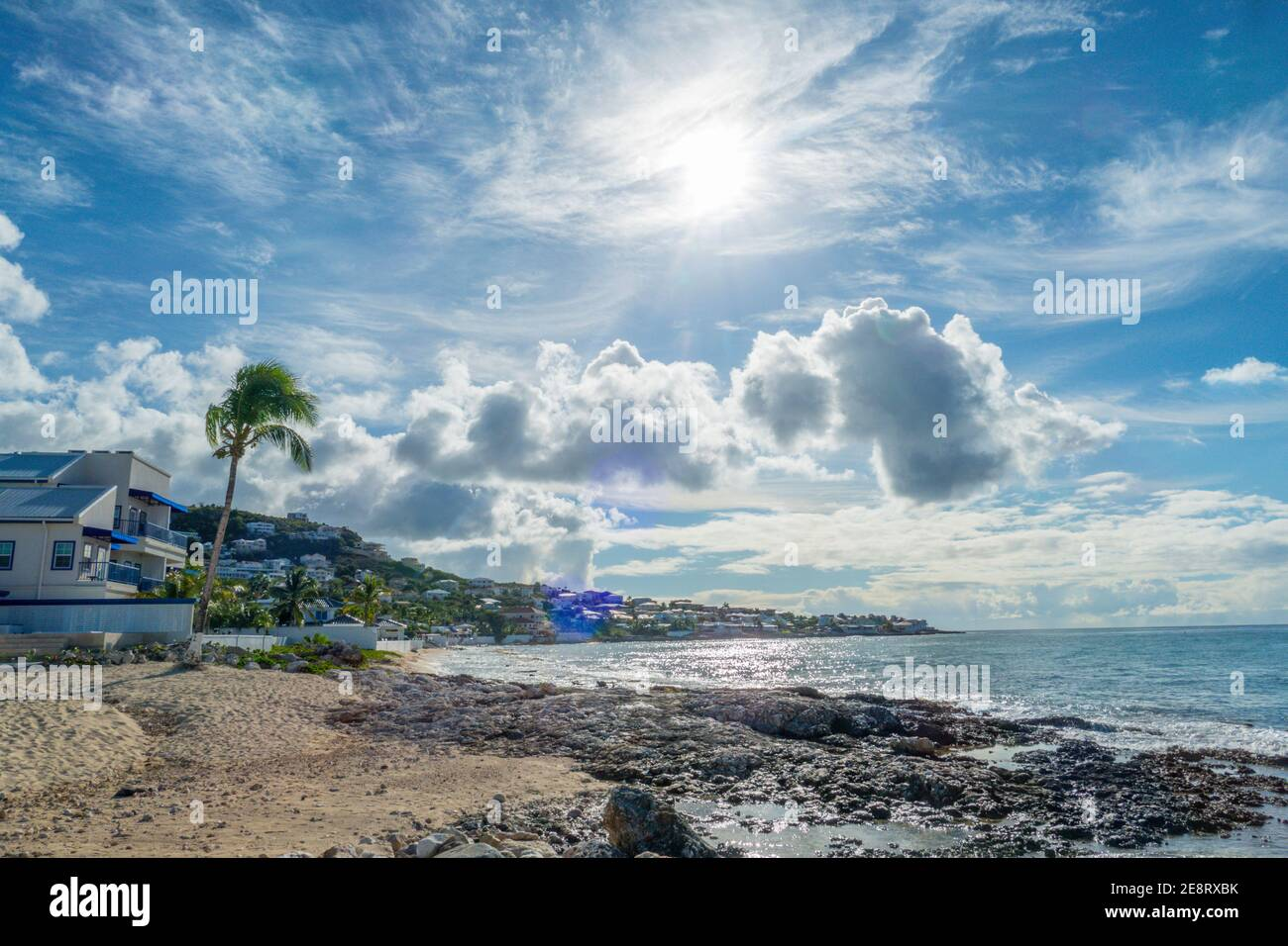 Beautiful white cloudy sky with the sun rising. Stock Photo
