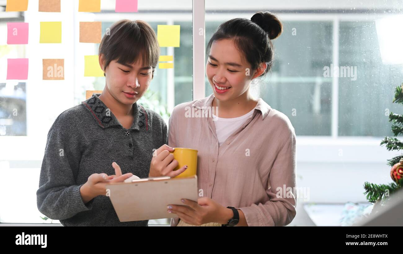 Two designers colleagues discussing new project in creative office. Stock Photo