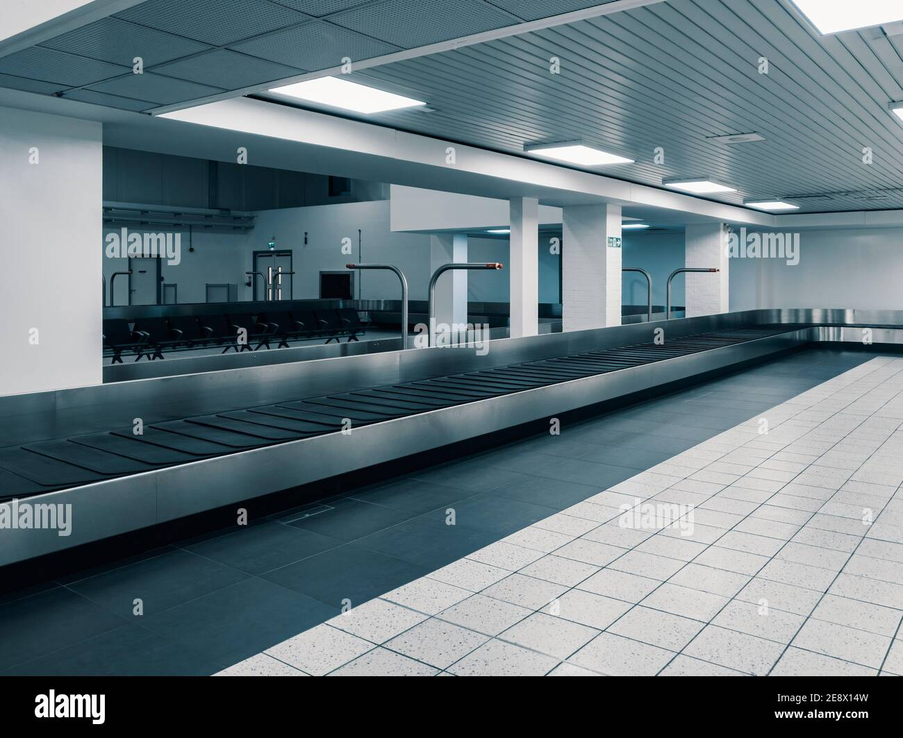 Covid-19 Lockdown - London Luton Airport - Empty Baggage Carousel at Arrivals - Effects of the travel ban due to the Novel Coronavirus Stock Photo