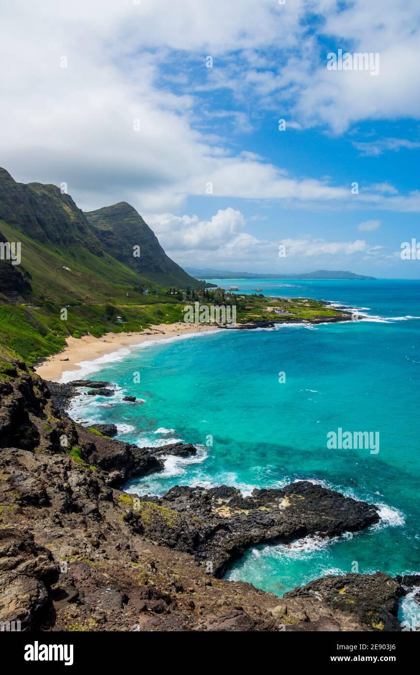 Rocky shoreline and pocket beach at Makapuʻu Point, western end of Oahu, Hawaii Stock Photo