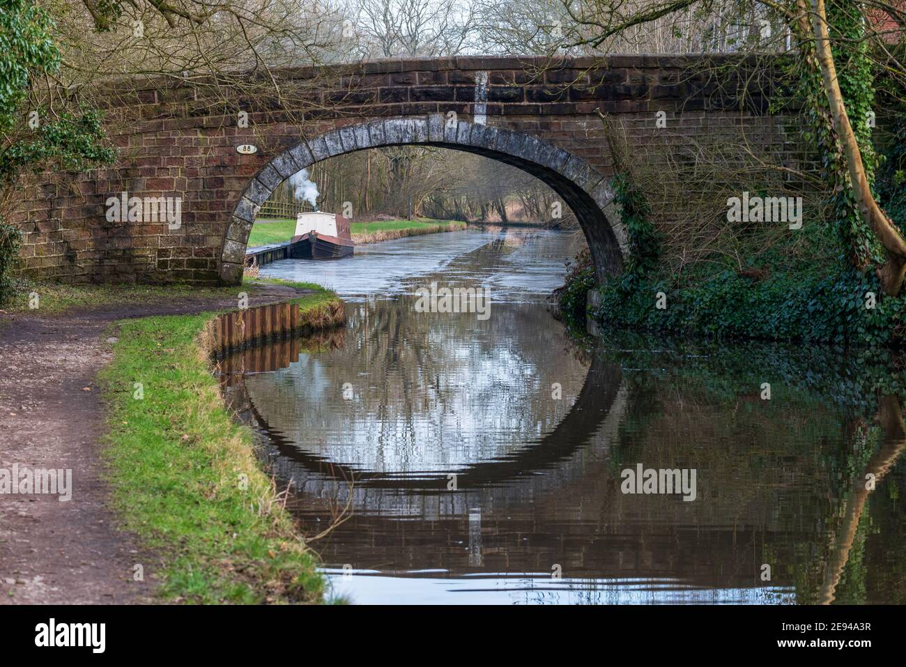 A single narrowboat moored on the Leeds Liverpool canal at Withnell Fold in Lancashire Stock Photo