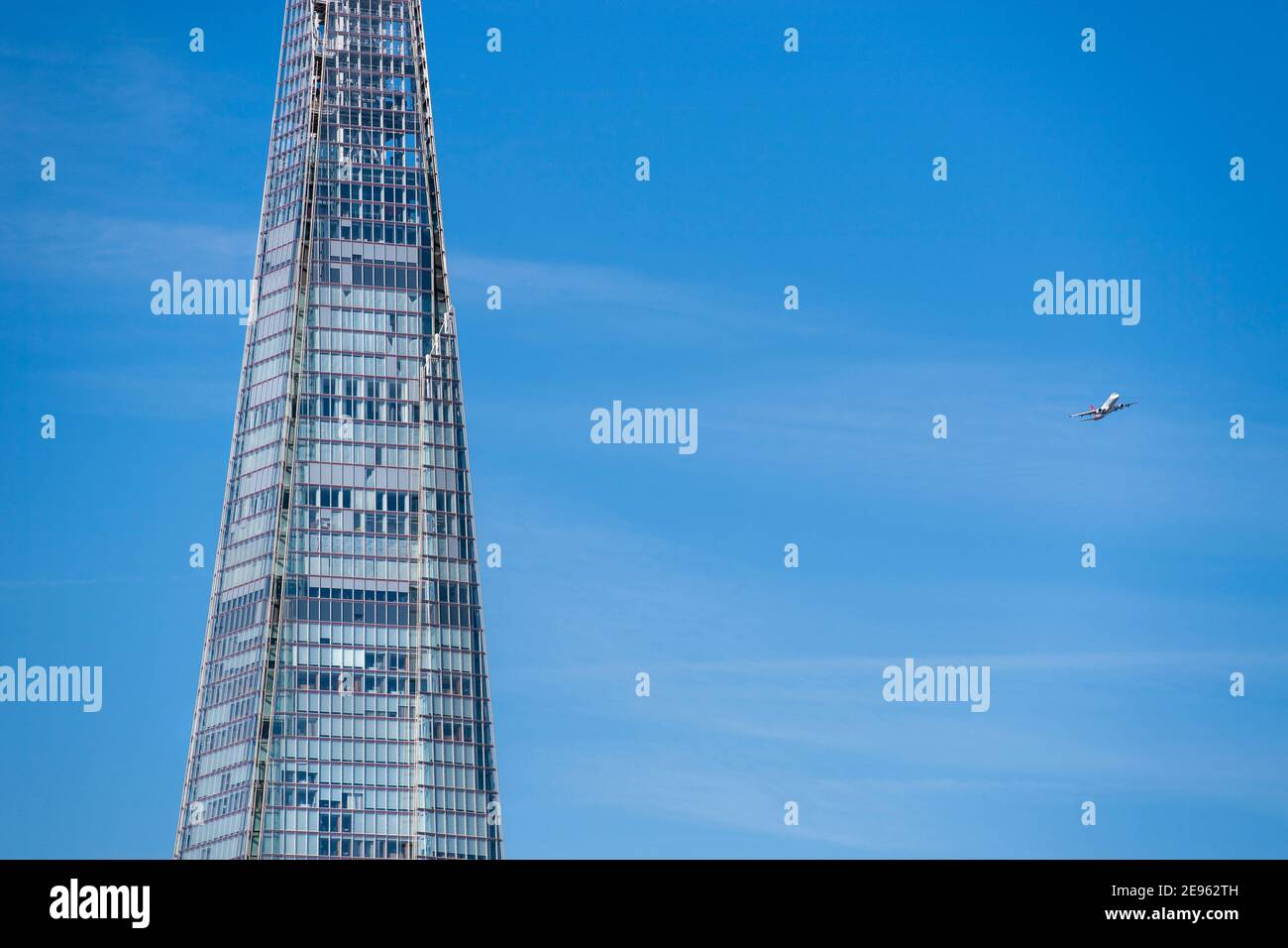 Low flying passenger plane close to the Shard on its final approach to landing at London City Airport, England, UK Stock Photo