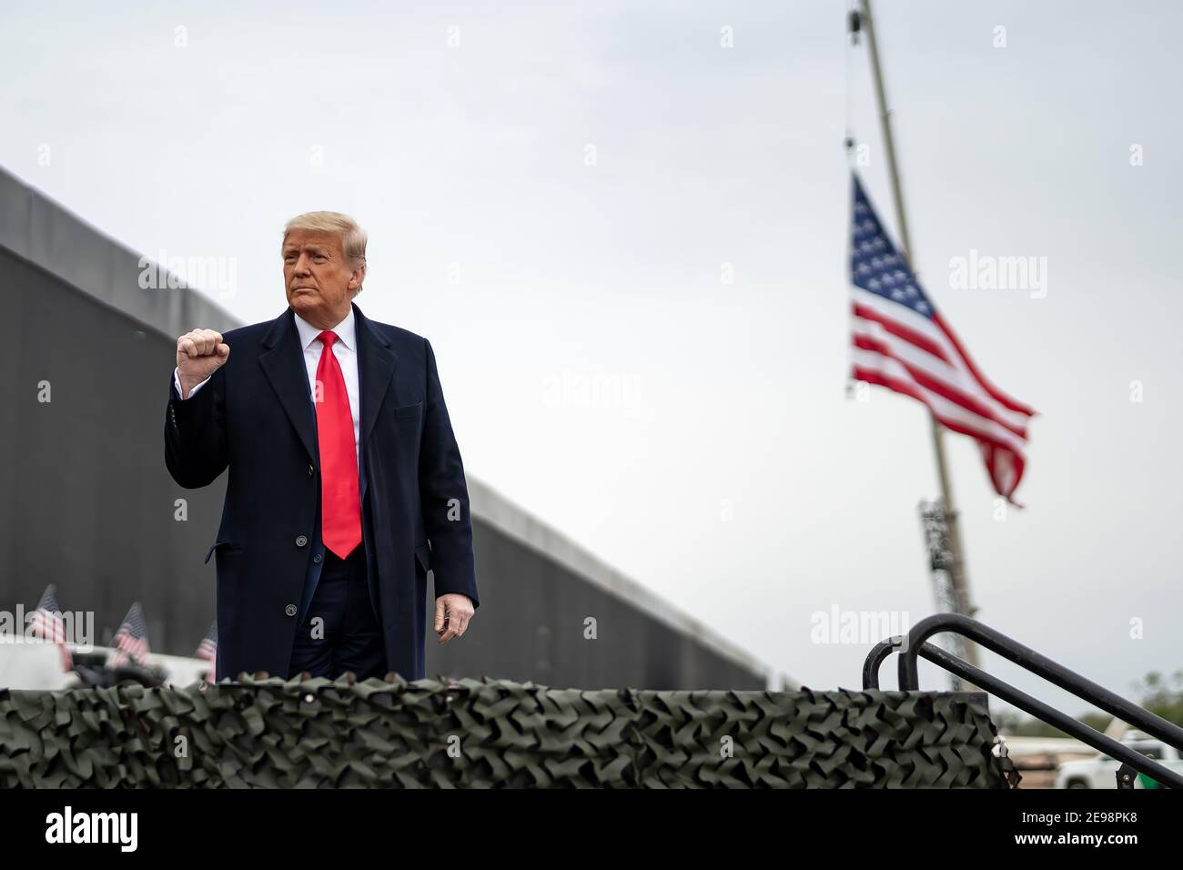 "PRESIDENT DONALD TRUMP VISITS THE BORDER WALL WITH MEXICO DURING THE LAST DAYS OF HIS PRESIDENCY. The Mexico–United States barrier, also known as the border wall, is a series of vertical barriers along the Mexico–United States border intended to reduce illegal immigration to the United States from Mexico. The barrier is not a continuous structure but a series of obstructions variously classified as ""fences"" or ""walls"".  Between the physical barriers, security is provided by a ""virtual fence"" of sensors, cameras, and other surveillance equipment. Stock Photo"