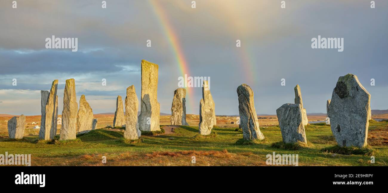 Isle of Lewis and Harris, Scotland: Double rainbow and clearing sky at the Callanish Standing Stones Stock Photo
