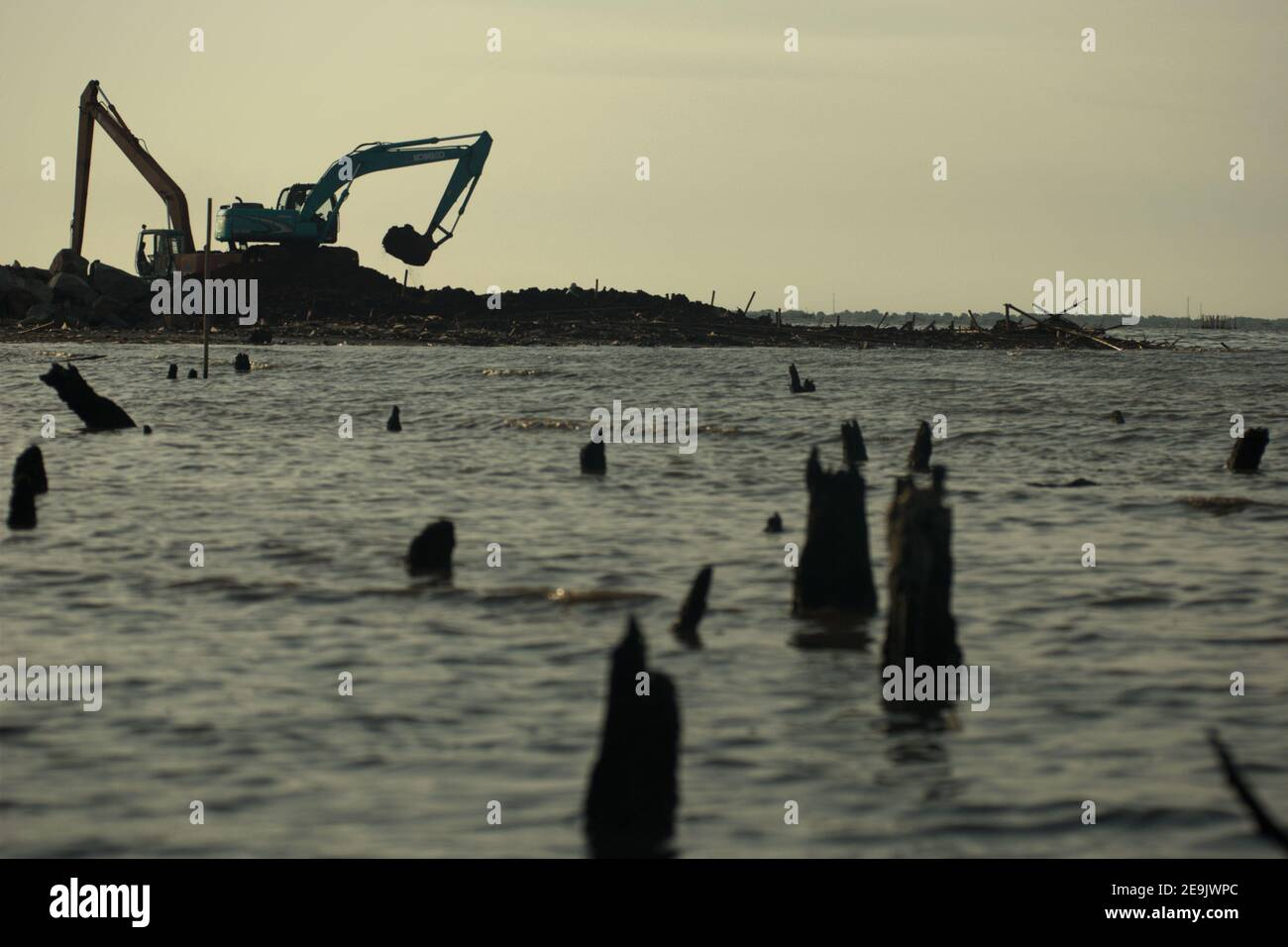 Land reclamation and beach landscaping activity in Pantai Indah Kapuk, close to a residential complex in the coastal area of Jakarta, Indonesia. Stock Photo