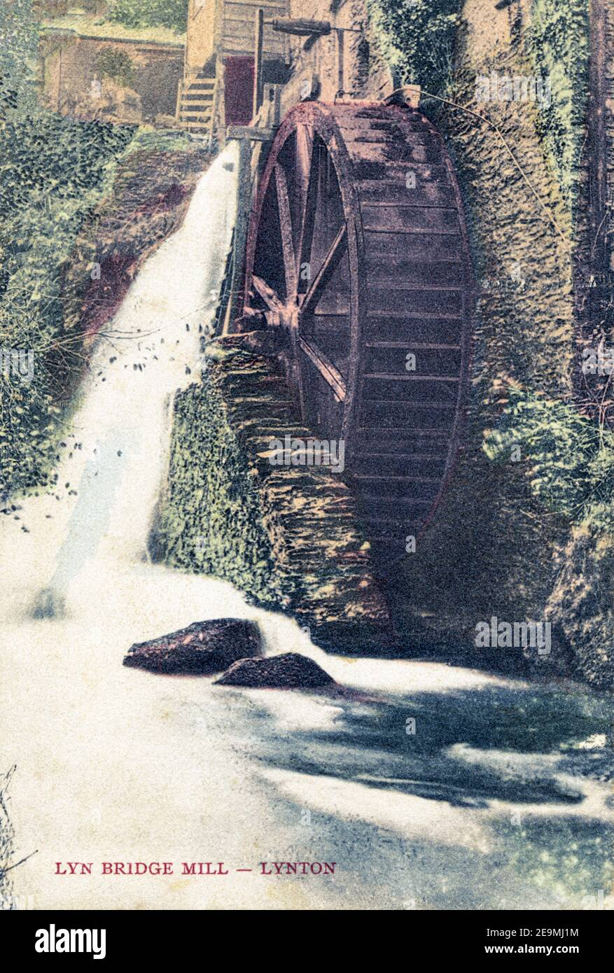 A coloured postcard of Lyn Bridge Mill, Lynton posted in 1905 Stock Photo