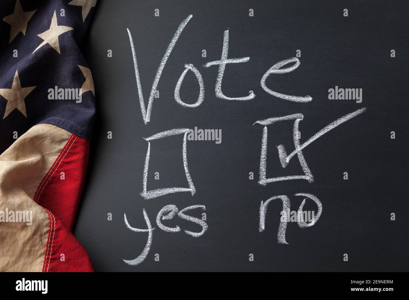 Vote Sign with No checkbox selected handwritten on a chalkboard bordered by a vintage American flag Stock Photo