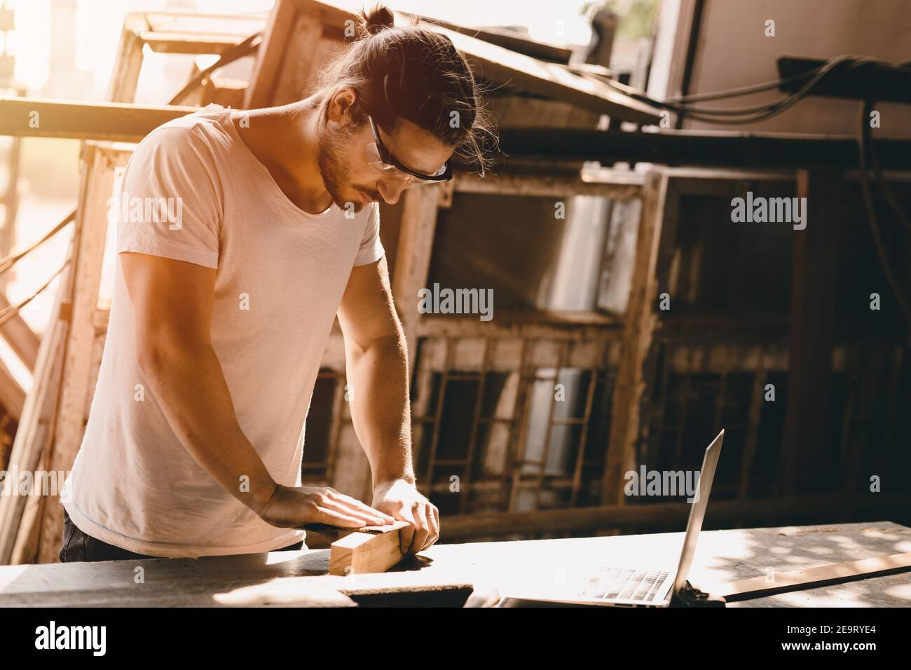 Carpenter man woodcraft working in furniture wood workshop with professional skill real people workman. Stock Photo