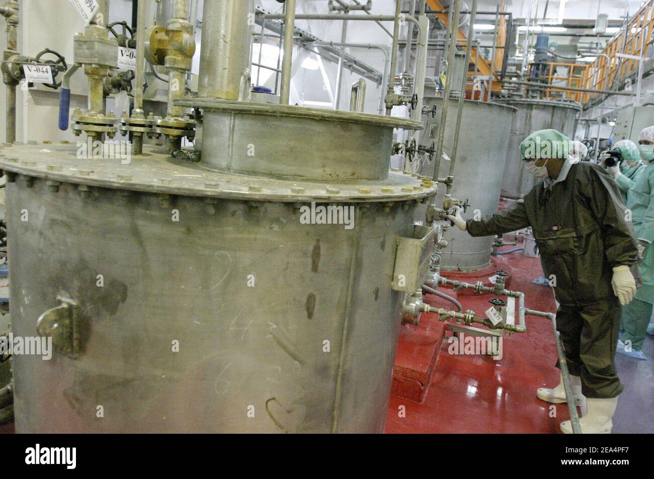 Iranian technicians work in the Uranium Conversion Facility (UCF) in Isfahan, Iran, on November 20, 2004. Iran said nuclear processing is set to resume at the Isfahan plant, the largest of its type in the country, on Wednesday. France, Britain and Germany have warned Iran of a major international crisis if the country goes ahead with its plans. Photo by ABACAPRESS.COM Stock Photo