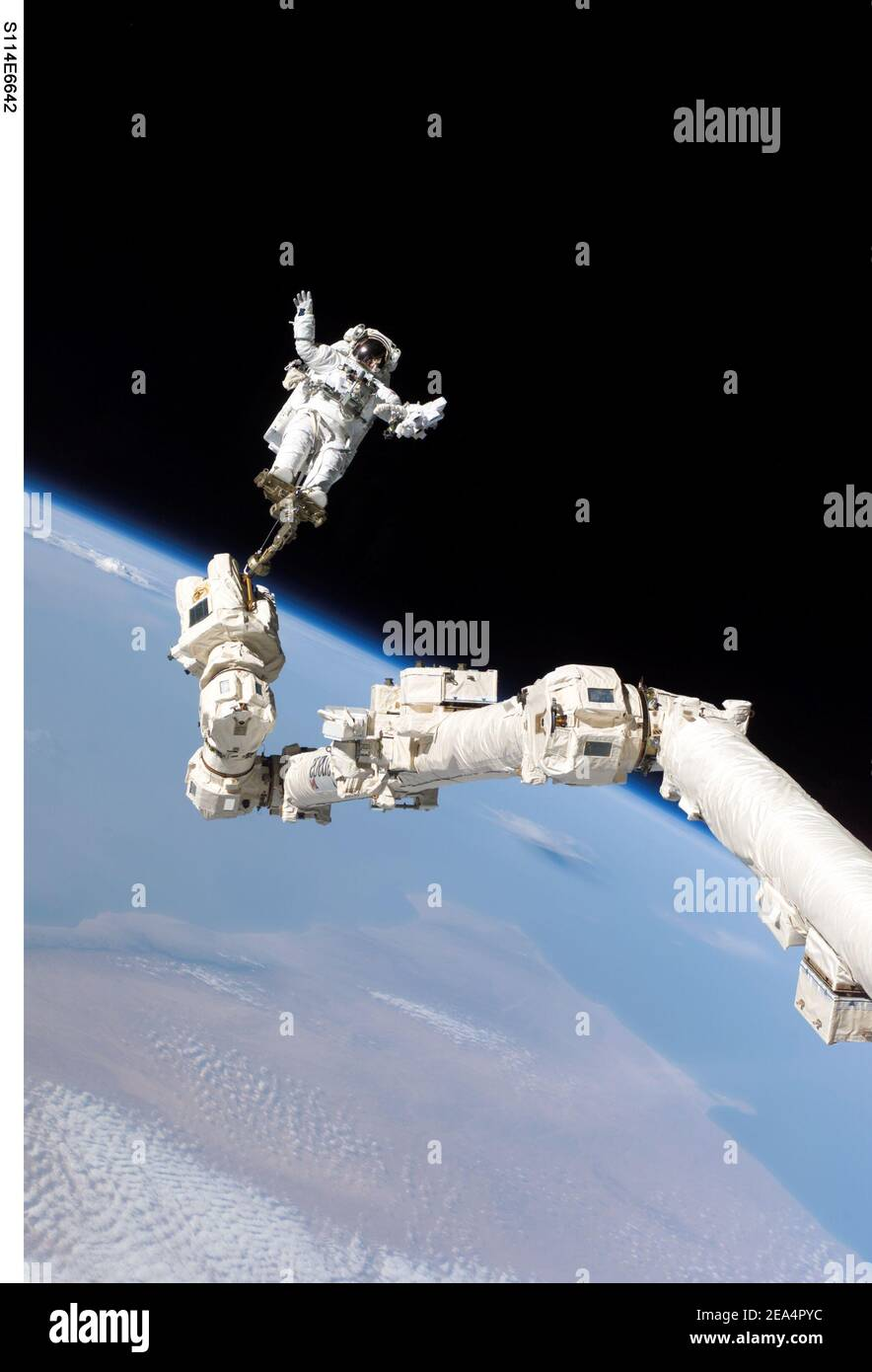 Astronaut Stephen K. Robinson, STS-114 mission specialist, anchored to a foot restraint on the International Space Station Canadarm2, participates in the missions third session of extravehicular activity (EVA) on August 3, 2005. The blackness of space and Earths horizon form the backdrop for the image. Photo by NASA/ABACAPRESS.COM Stock Photo