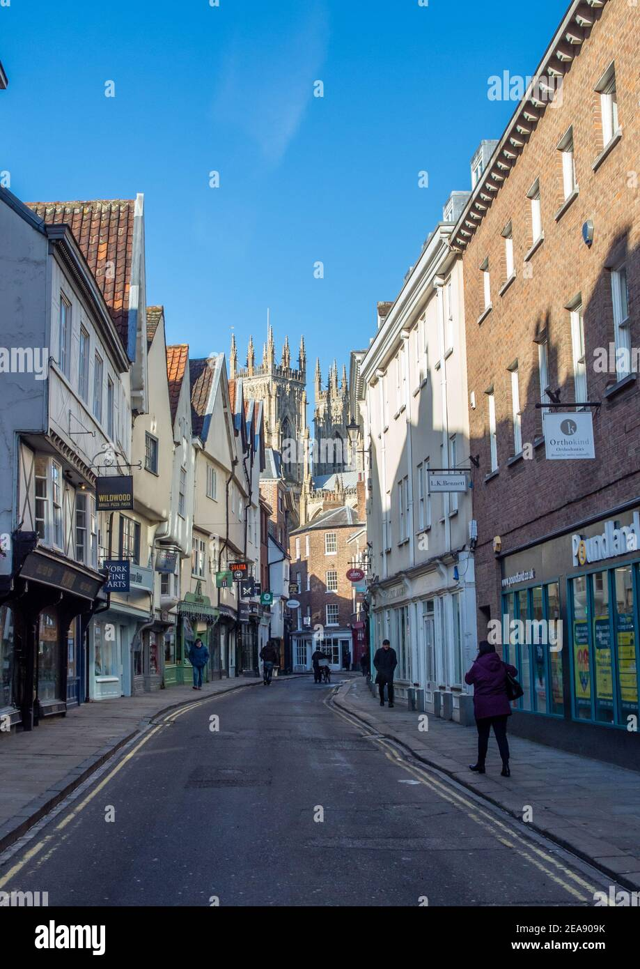 York, Yorkshire, UK, 01/02/2021 - A quiet Petergate in York with few people on the street looking towards York Minster. Stock Photo