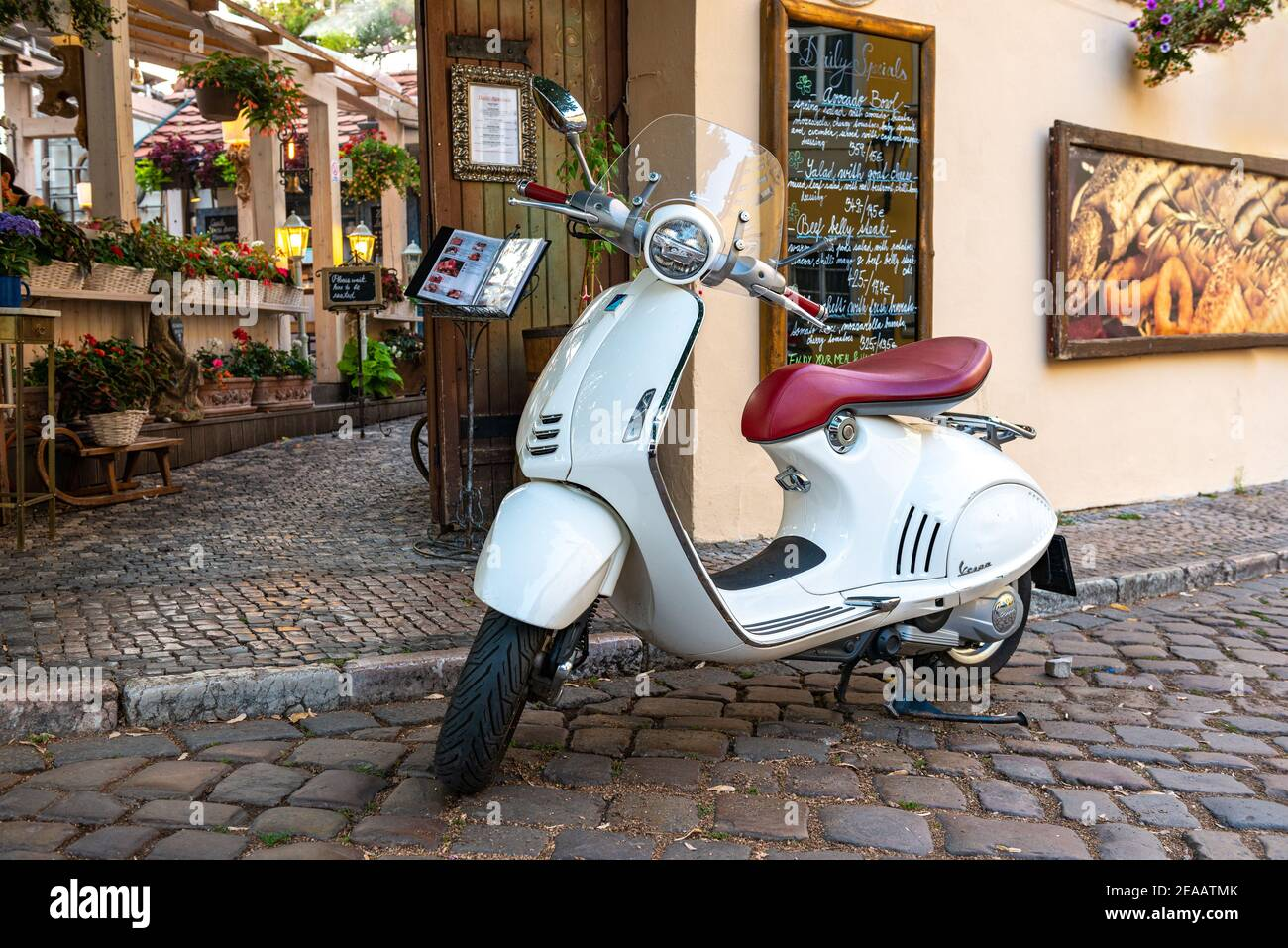 Vintage white scooter parked July 30, 2018 on the street of Prague Stock Photo