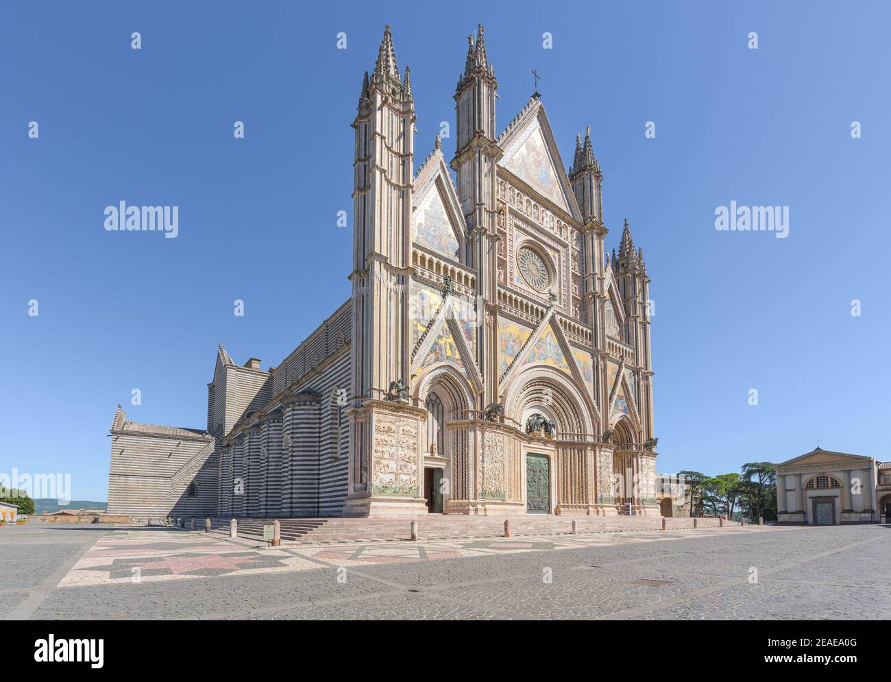 Renaissance facade of Orvieto cathedral, with rose window and gothic style spires and sculptures, a famous landmark in Orvieto medieval town in Umbria Stock Photo