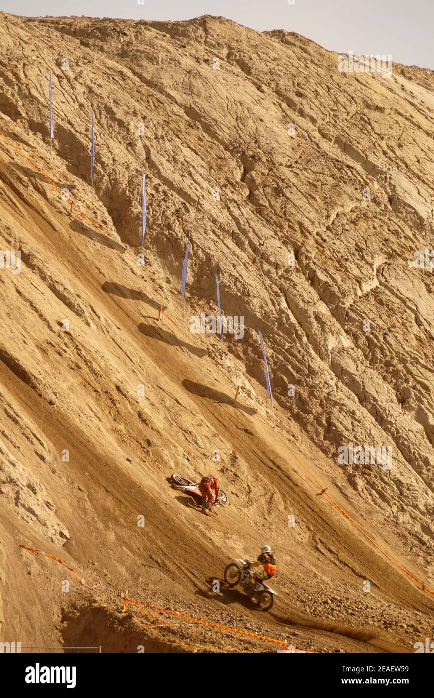 Steep uphill climb during enduro competition. Two players in action. Stock Photo