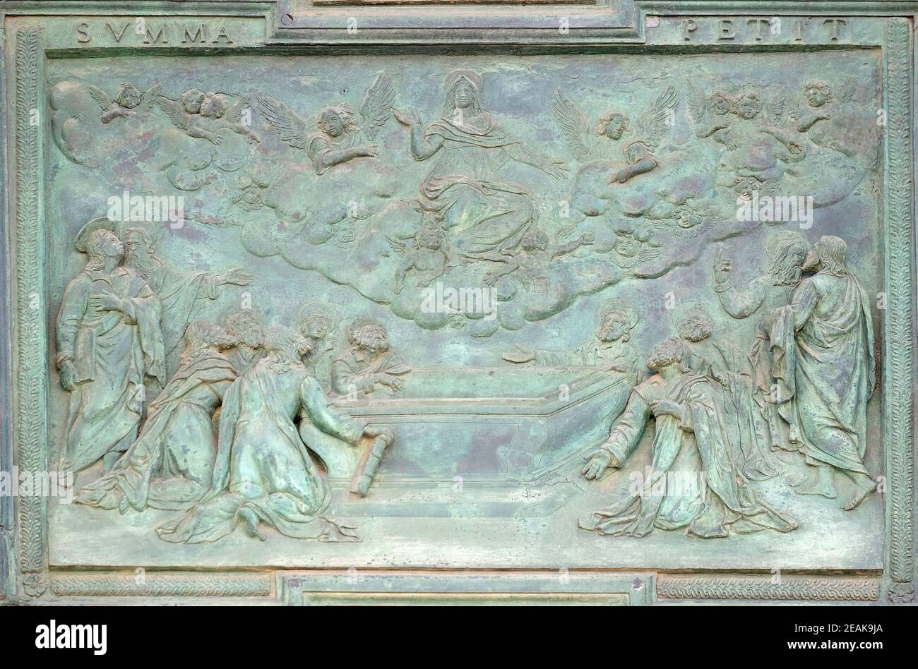 Assumption of the Virgin Mary, panel from Giambologna's school, collocated in the central portal of the Cathedral St. Mary of the Assumption in Pisa, Italy Stock Photo