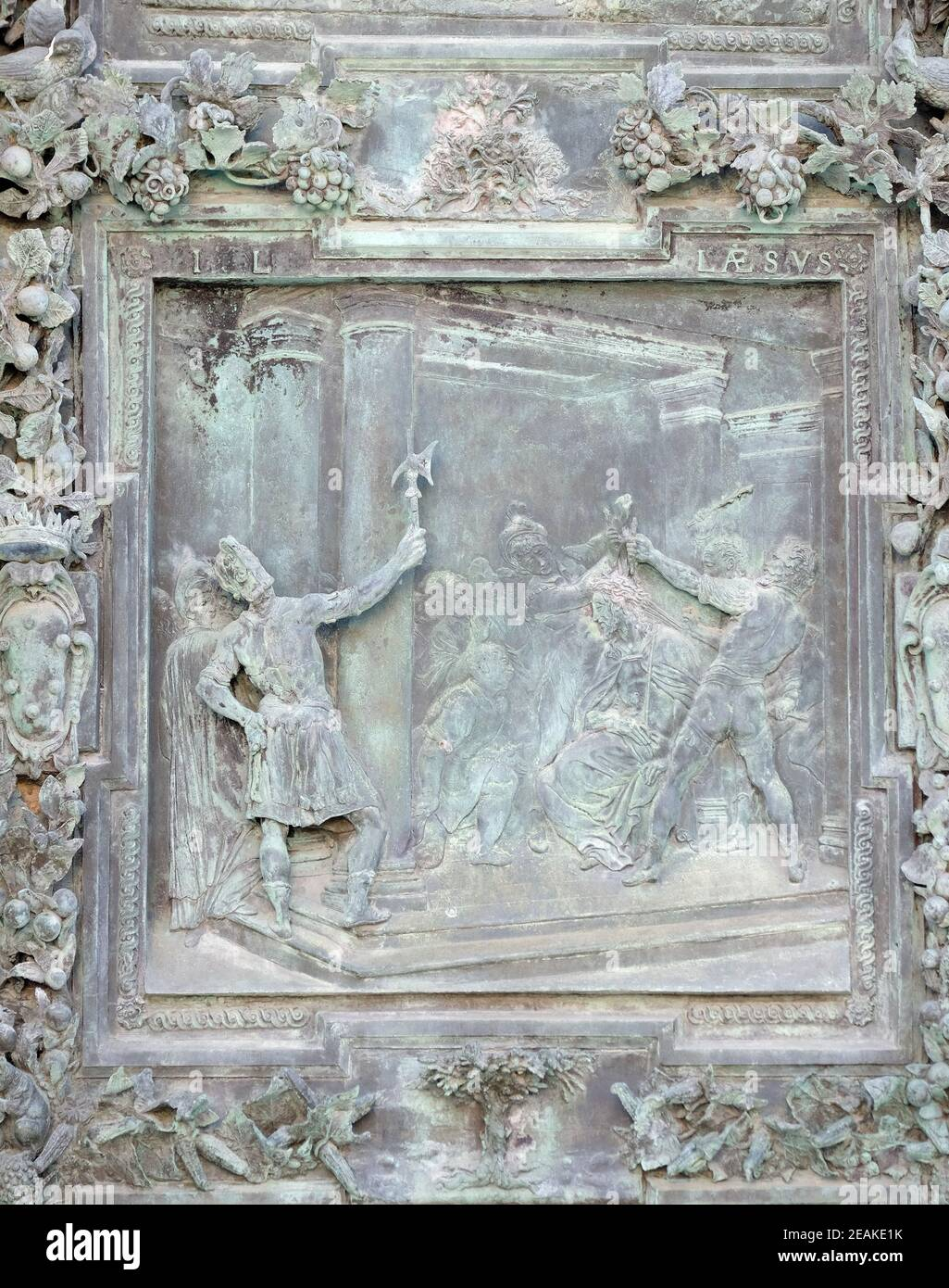 Christ Crowned with Thorns, sculpture work from Giambologna's school, portal of the Cathedral St. Mary of the Assumption in Pisa, Italy Stock Photo