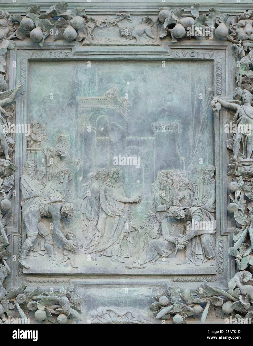 The payment of the tribute, sculpture work from Giambologna's school, collocated in the left portal panel of the Cathedral St. Mary of the Assumption in Pisa, Italy Stock Photo