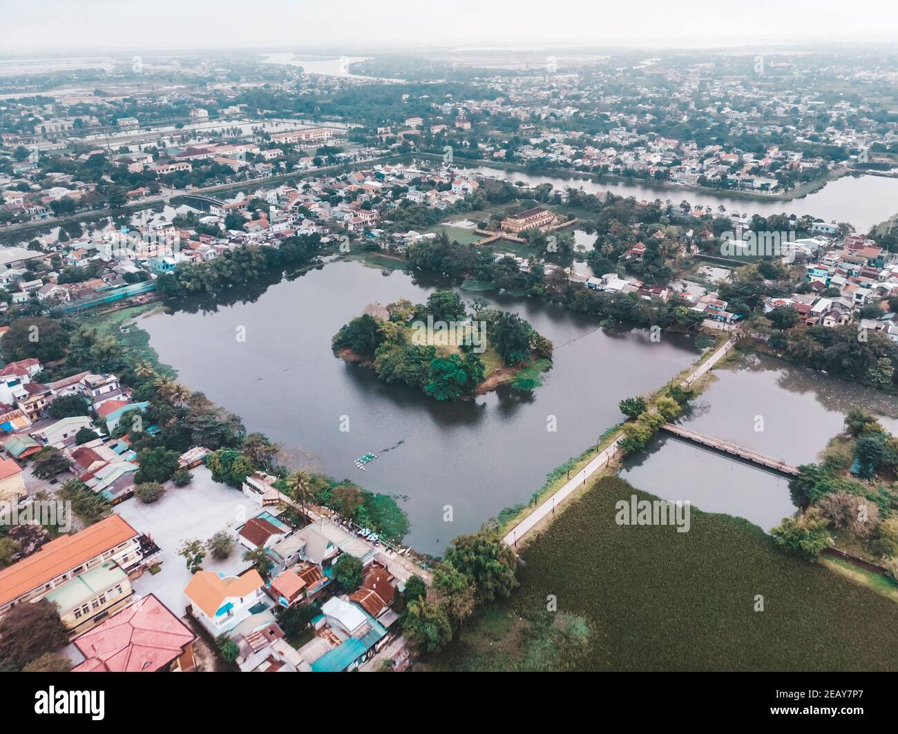 The city of hue in the mist of Vietnam. The view from the top. Aerial view. Rainy season, winter. square lake in the city centre of hue Stock Photo