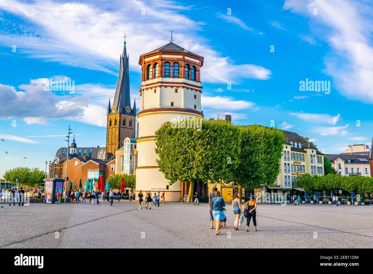 DUSSELDORF, GERMANY, AUGUST 10, 2018: View of Burgplatz with Schifffahrt museum and Saint Lambertus church in Dusseldorf, Germany Stock Photo