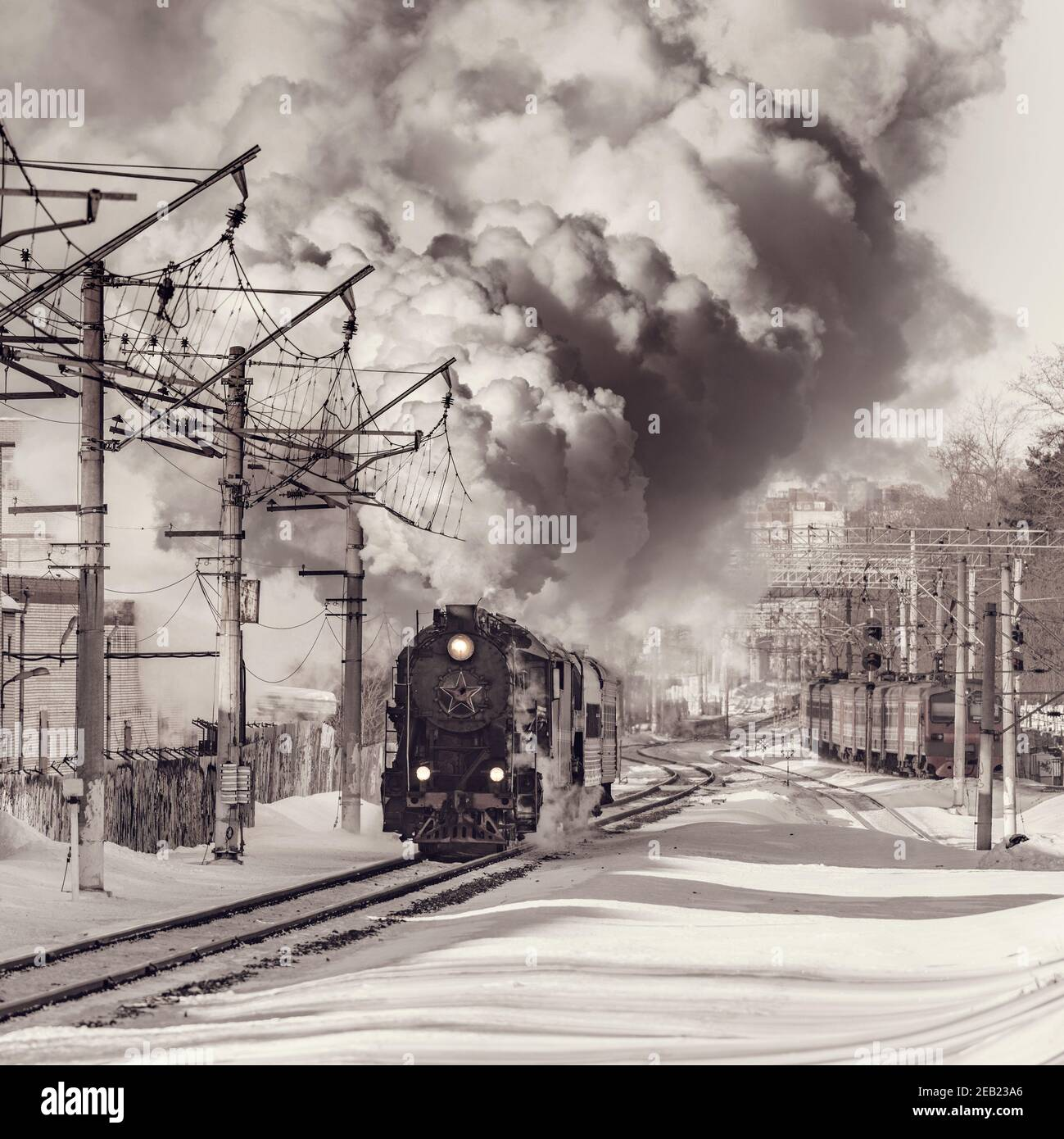 Korolev, Russia - February 23, 2019: Retro train moves at winter day time. Stock Photo
