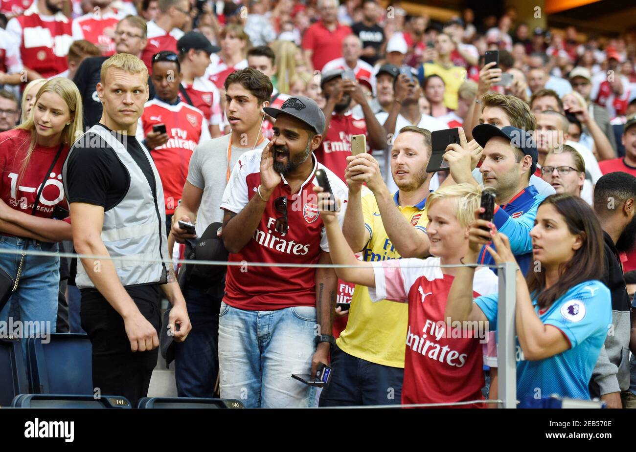 Soccer Football - Pre Season Friendly - Lazio v Arsenal - Friends Arena, Stockholm, Sweden - August 4, 2018   Arsenal fans take photos during the match   REUTERS/Fabian Bimmer Stock Photo