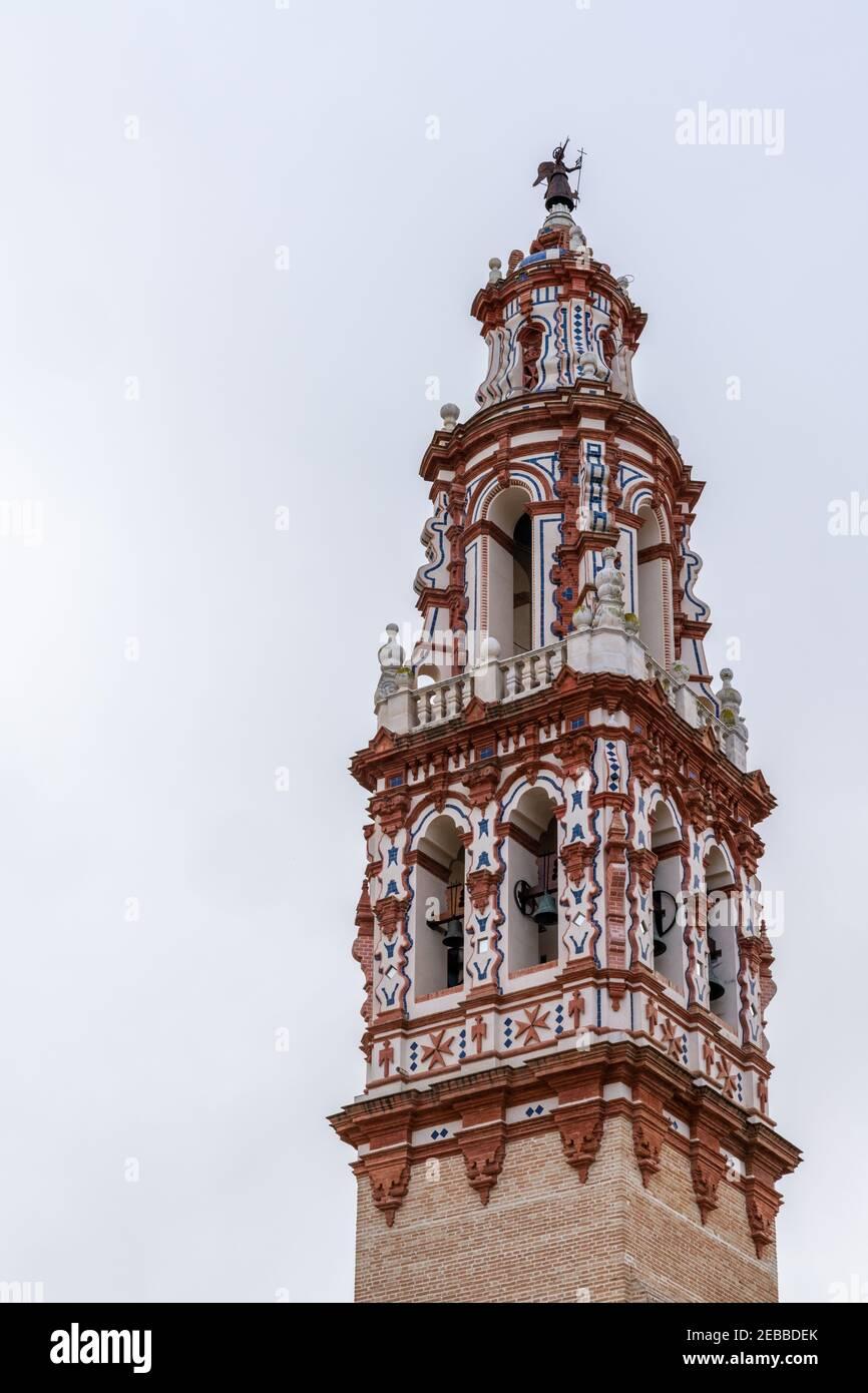 Ecija, Spain - 1 February, 2021: Church of San Juan Bautista bell tower in the heart of the old town of Ecija Stock Photo