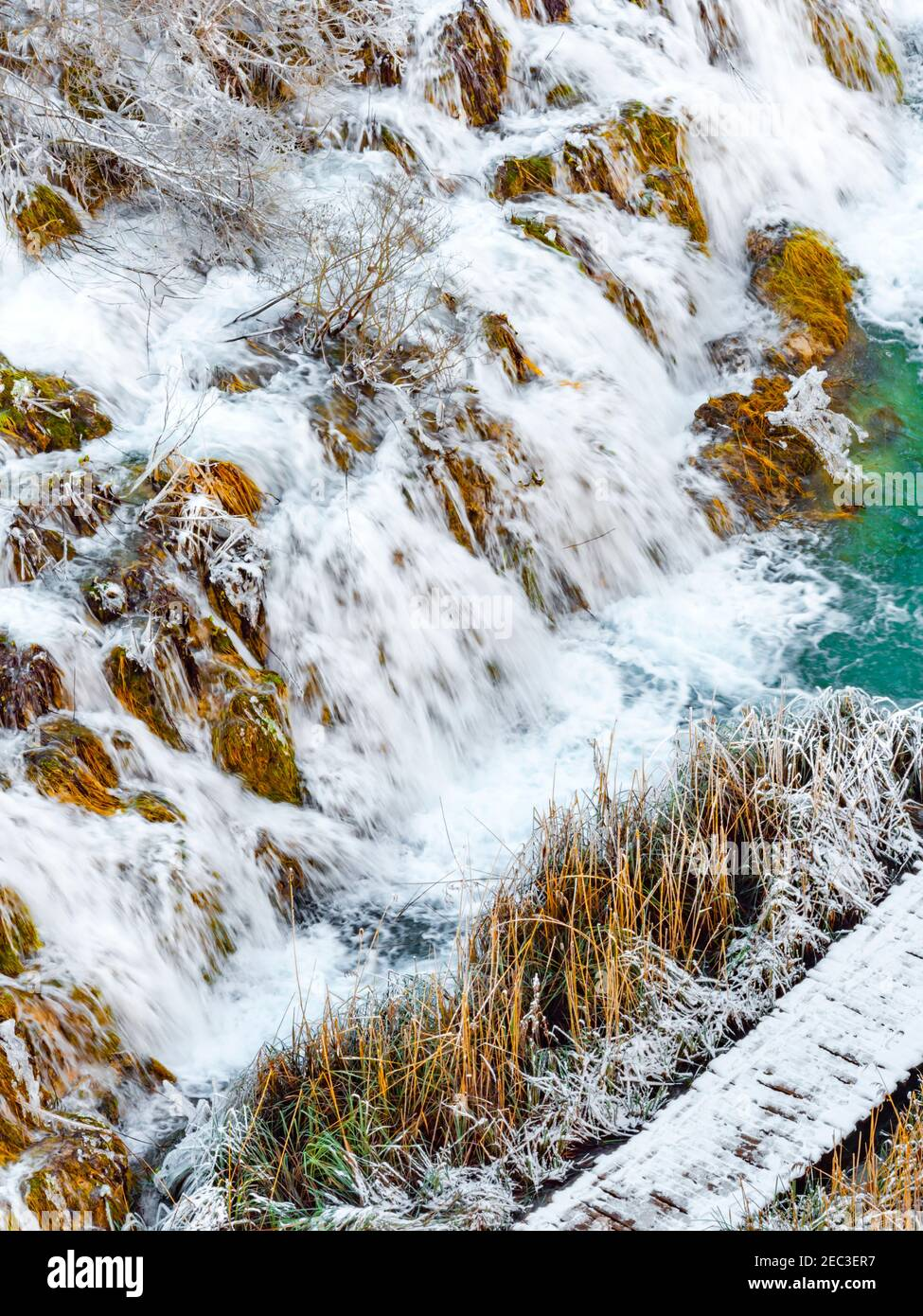 Cascading waterfalls in national park Plitvice lakes Croatia Europe Winter under covered cover snow ice waterflow water flowing flow Stock Photo