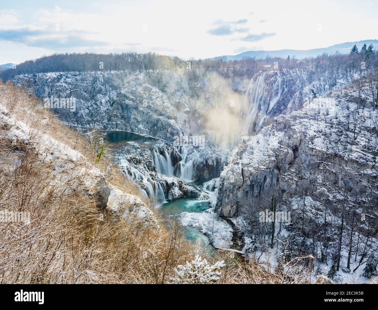 Daily fog before stunning Veliki slap Big waterfall in national park Plitvice lakes Croatia Europe Winter under covered cover snow ice waterflow water Stock Photo