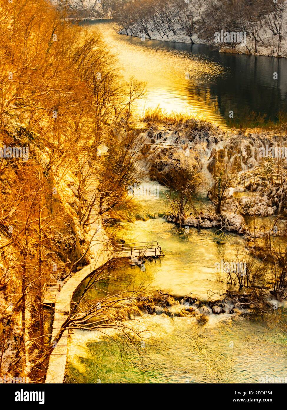 Warm light warmth sunset in national park Plitvice lakes Croatia Europe Winter waterflow water flowing flow creative altered color Stock Photo