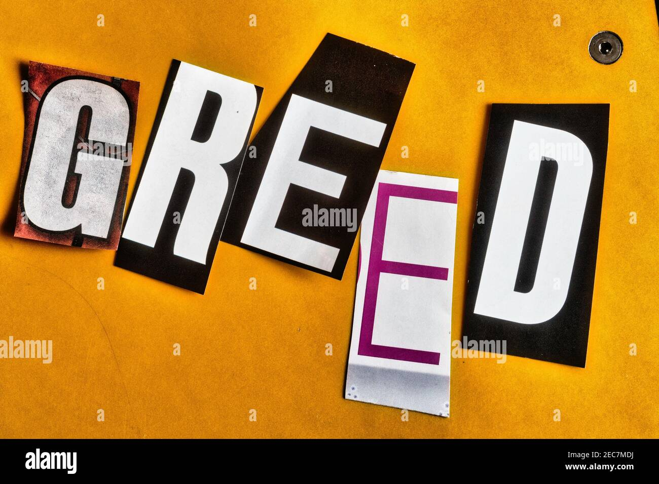 """The word """"Greed"""" using cut-out paper letters in the ransom note effect typography Stock Photo"""