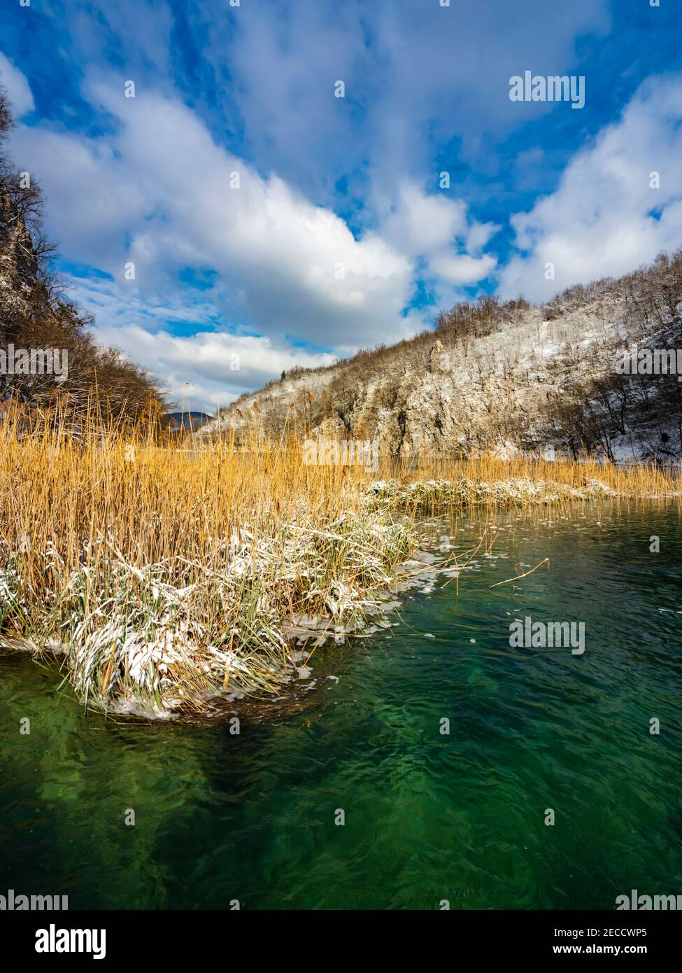 National park Plitvice lakes Croatia Europe late Winter under covered cover snow ice waterflow water flowing flow Stock Photo
