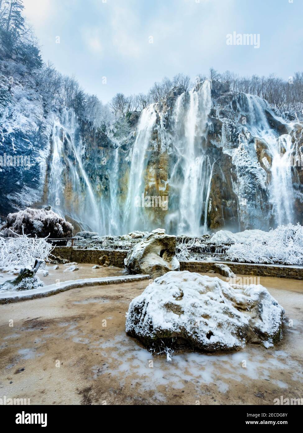Veliki slap in National park Plitvice lakes in Croatia Europe in Winter under covered cover snow and ice famous landmark place Stock Photo