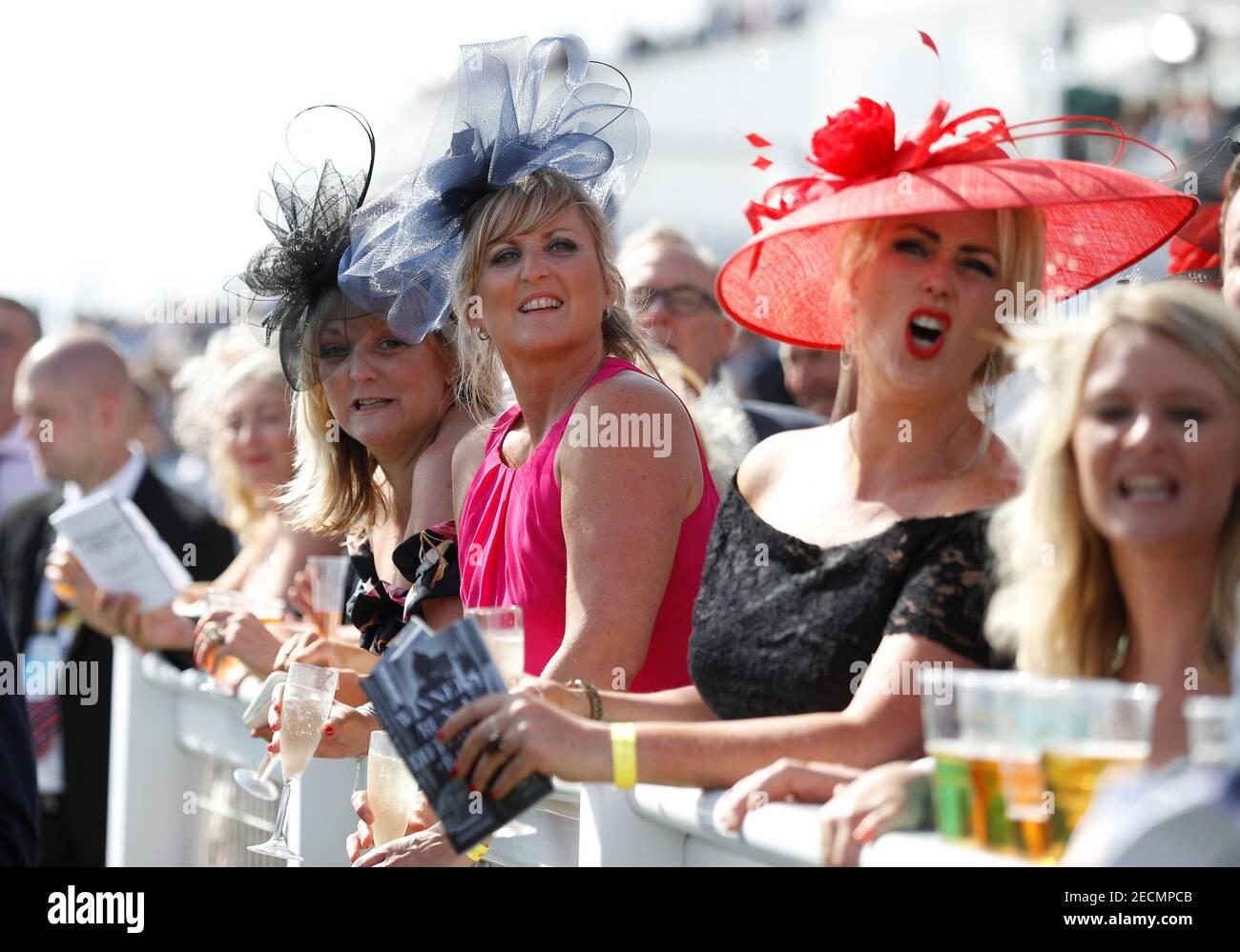Horse Racing - Derby Festival - Epsom Downs Racecourse, Epsom, Britain - June 1, 2018   Racegoers during the 4.30 Investec Oaks   REUTERS/Peter Nicholls Stock Photo