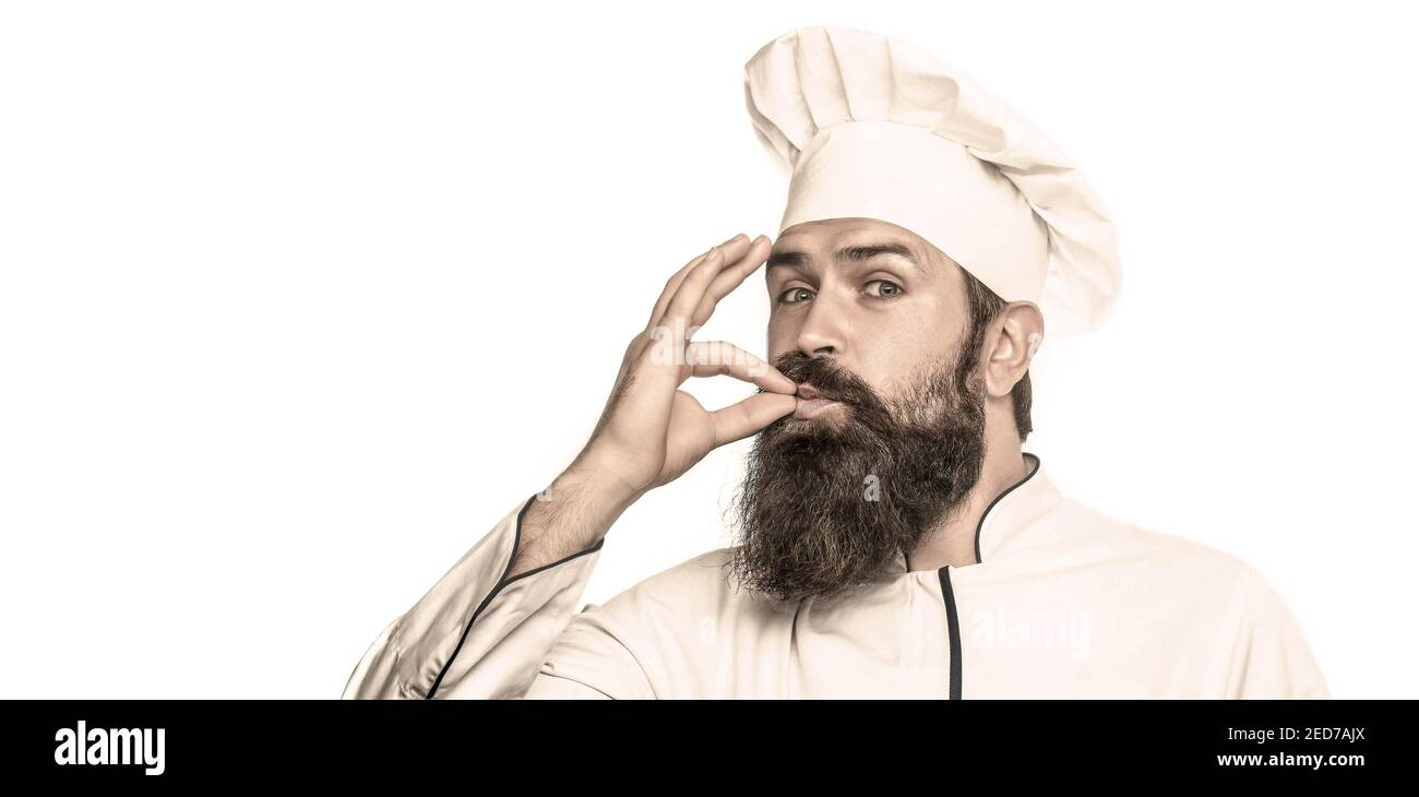 Chef, cook making tasty delicious gesture by kissing fingers. Cook hat. Bearded chef, cooks or baker. Bearded male chefs, perfect. Professional chef Stock Photo