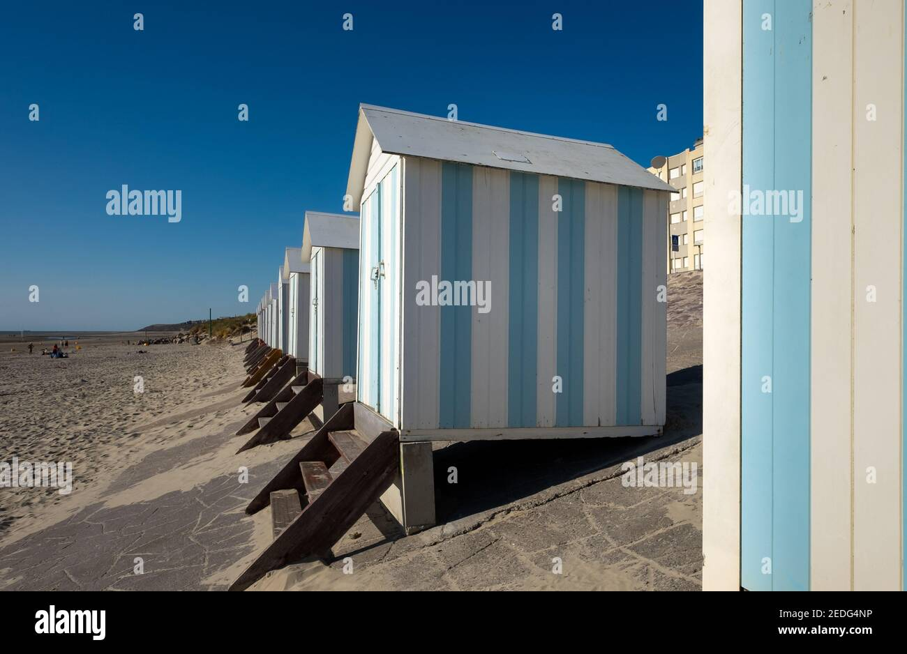 Striped beach cabins in Hardelot, France. Stock Photo