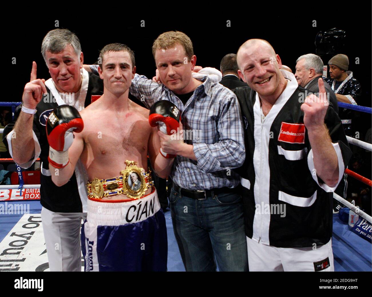 Boxing - Colin Lynes v Paul McCloskey - British Light-Welterweight Title - Goresbrook Leisure Centre, Dagenham - 5/12/08  Paul McCloskey celebrates victory with the belt and trainer John Breen (L)  Mandatory Credit: Action Images / Andrew Couldridge Stock Photo