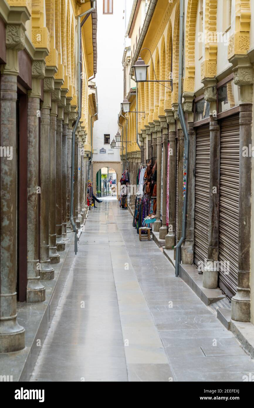 Granada, Spain - 4 February, 2021: An empty and narrow pedestrian alley in the heart of the old city center in Granada Stock Photo