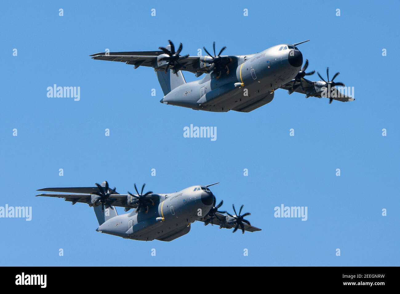 "07.06.2018, Wunstdorf, Lower Saxony, two Airbus A400M ""Atlas"" in flight, taken on spotterday on Air Transport Wing 62. The Airbus A400M has been replacing transport aircraft from seven NATO countries since 2013. In the German Air Force, the A400M is to replace the old Transall C-160 from the 1960s. With a higher payload, range and speed, the A400M should have the same capabilities and also be able to be used as a tanker aircraft. The first A400M was delivered to Germany at the end of 2014, the last of 53 pieces is to take place in 2026. 