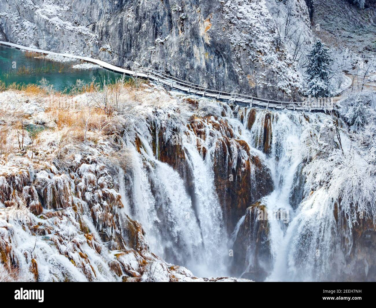 Waterfalls in national park Plitvice lakes Croatia Europe Winter under covered cover snow ice waterflow water flowing flow streaming water stream Stock Photo